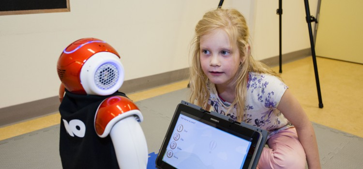 Children with diabetes play with robot